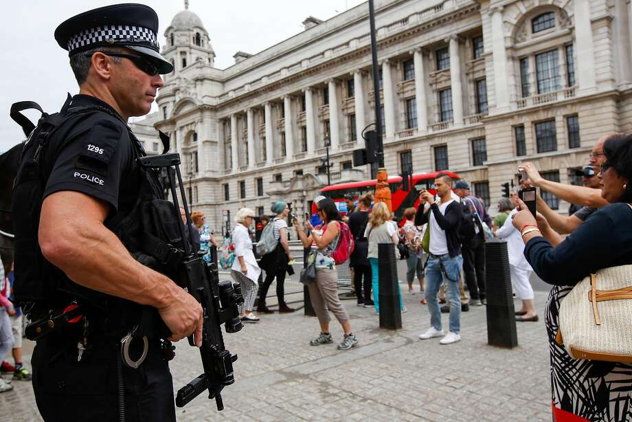An armed British police officer on security patrol among tourists at Horse Guards Parade in London, U.K., on Friday July 15, 2016. Eight months after a murderous rampage in Paris, a deadly attack in the coastal city of Nice on Bastille Day left at least 84 people dead and scores injured, threatening to throw a still-traumatized France into a tailspin and raising terror alarms across Europe. Photographer: Luke MacGregor/Bloomberg Photo: Luke MacGregor, Bloomberg