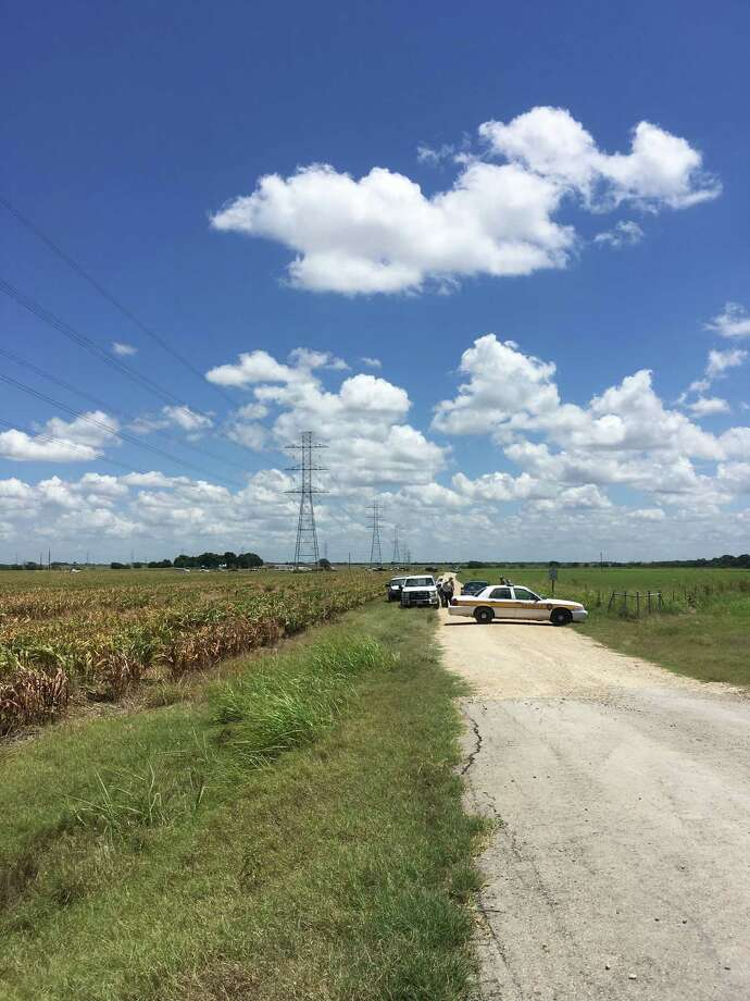 Police cars block access to the site where a hot air balloon crashed early Saturday, July 30, 2016, near Lockhart, Texas.  At least 16 people were on board the balloon, which Federal Aviation Administration spokesman Lynn Lunsford said caught fire before crashing into a pasture shortly after 7:40 a.m. Saturday near Lockhart. No one appeared to survive the crash, authorities said. Photo: James Vertuno, AP / AP