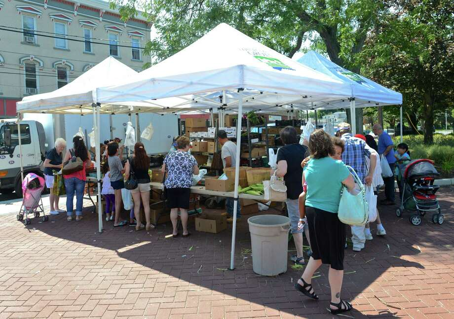 The Smith's Acres booth at the CityCenter Danbury Farmers Market, is held every Friday, from 11 a.m. to 5 p.m. in Kennedy Park from Mid-June through the end of September. Friday, August 14, 2015, in Danbury, Conn. Photo: H John Voorhees III / Hearst Connecticut Media / The News-Times