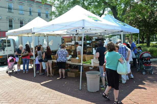 The Smith's Acres booth at the CityCenter Danbury Farmers Market, is held every Friday, from 11 a.m. to 5 p.m. in Kennedy Park from Mid-June through the end of September. Friday, August 14, 2015, in Danbury, Conn.