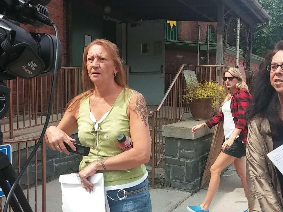 Loreen Hackett, a Hoosick Falls resident, outside the armory on Saturday, July 30, 2016. (Wendy Liberatore/Times Union)