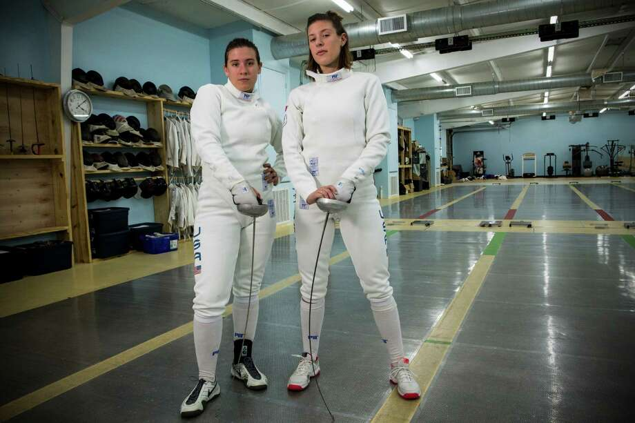 Olympic fencers Courtney Hurley, 25, left, and her sister, Kelley, 28, pose for a portrait at Alliance Fencing Academy while preparing for the upcoming Rio Olympics on Thursday, July 14, 2016, in Houston. ( Brett Coomer / Houston Chronicle ) Photo: Brett Coomer, Staff / © 2016 Houston Chronicle