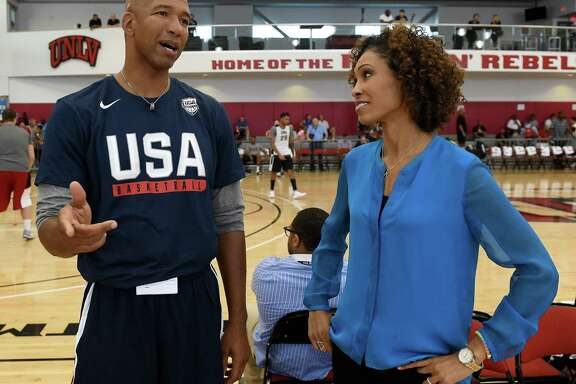 Assistant coach Monty Williams (L) of the 2016 USA Basketball Men's National Team talks with sportscaster Sage Steele during a practice session at the Mendenhall Center on July 20, 2016 in Las Vegas.