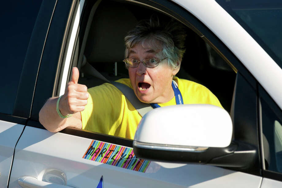 Photo provided | Andrew Knapik Photography Midlander Marilynn Marry gives a thumbs up from a support vehicle during the 2015 Wish-A-Mile Bicycle Tour, one of Make-A-Wish Michigan's biggest fundraisers / Andrew Knapik