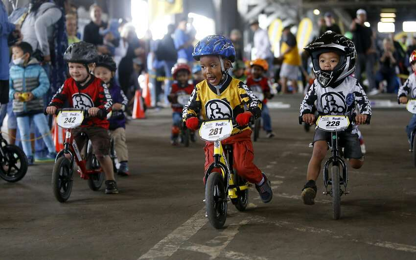 2-year-old Zach Legendary,281 of El Cerrito heads into the first turn during the Strider Cup World Championship bicycle race at Pier 35 along the Embarcadero in San Francisco, California, on Sat. July 30, 2016.