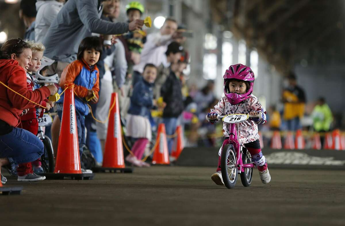 Miku Shiozawa of Japan, in one of her final heats and went on to win the 2-year-old division during the Strider Cup World Championship bicycle race at Pier 35 along the Embarcadero in San Francisco, California, on Sat. July 30, 2016.