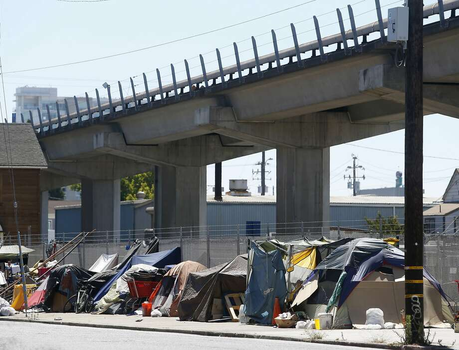 This homeless camp has sprung up at 5th and Brush streets in Oakland. Photo: Paul Chinn, The Chronicle