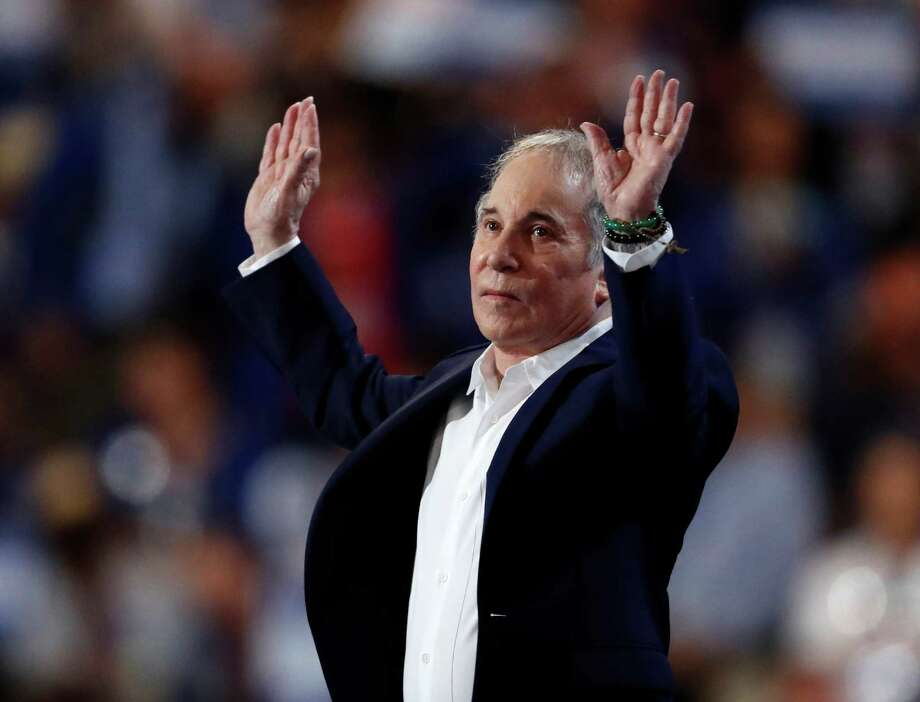Singer/songwriter Paul Simon takes the stage to perform during the first day of the Democratic National Convention in Philadelphia , Monday, July 25, 2016. (AP Photo/Paul Sancya) Photo: Paul Sancya, STF / Copyright 2016 The Associated Press. All rights reserved. This material may not be published, broadcast, rewritten or redistribu