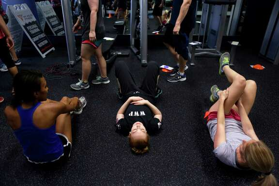 Workout participants cool down after class at My House Fitness in the Heights on Saturday, July 16, 2016, in Houston. (Annie Mulligan / Freelance)
