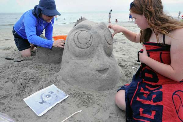 Darrell DeMakes of Riverside works on Dorie with the help of his 12-year-old daughter Demi DeMakes during the annual Sandblast! sand sculpture competition sponsored by the Greenwich Arts Council and the Town of Greenwich Department of Parks and Recreation at Greenwich Point, Conn., Saturday, July 30, 2016.