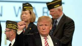 Donald Trump, the Republican presidential nominee, pumps his fist toward the crowd after addressing the 117th annual VFW National Convention at the Charlotte Convention Center on Tuesday, July 26, 2016. (David T. Foster III/Charlotte Observer/TNS)