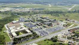 A look at the 25th Air Force complex from the air. The building sits on a slightly elevated part of Joint base San Antonio-Lackland that is often called Security Hill. The 25th Air Force is the building on the lower left hand side of the photo.Aerial view of Headquarters 25th Air Force (lower left) and Security Hill at JBSA-Lackland here in San Antonio, Texas. The 25th is the home of Intelligence, Surveillance and Reconnaissance an Electronic Warfare capabilities for the U.S. Air Force. View is looking east from Military Dr. towards Port S.A. and downtown. USAF photo