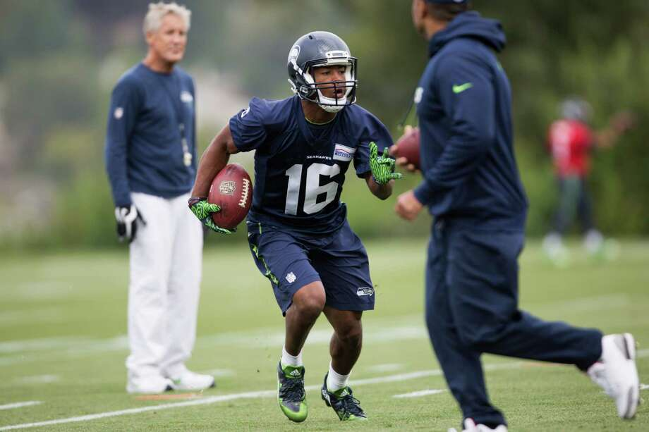 Seahawks wide receiver Tyler Lockett runs a drill as head coach Pete Carroll watches during the first day of training camp, at Virginia Mason Athletic Center in Renton on Saturday, July 30, 2016. Photo: GRANT HINDSLEY, SEATTLEPI.COM / SEATTLEPI.COM