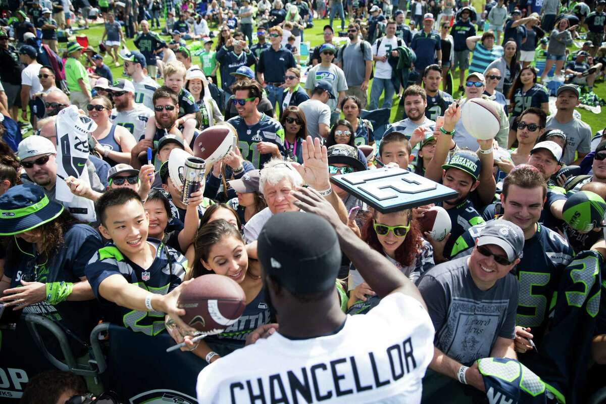 Seahawks safety Kam Chancellor signs autographs for fans following the first day of training camp, at Virginia Mason Athletic Center in Renton on Saturday, July 30, 2016.