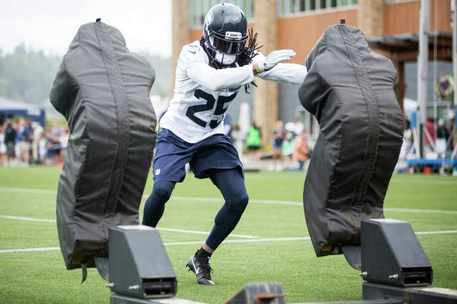 Seahawks cornerback Richard Sherman practices on a bull sled during the first day of training camp, at Virginia Mason Athletic Center in Renton on Saturday, July 30, 2016. Photo: GRANT HINDSLEY, SEATTLEPI.COM / SEATTLEPI.COM