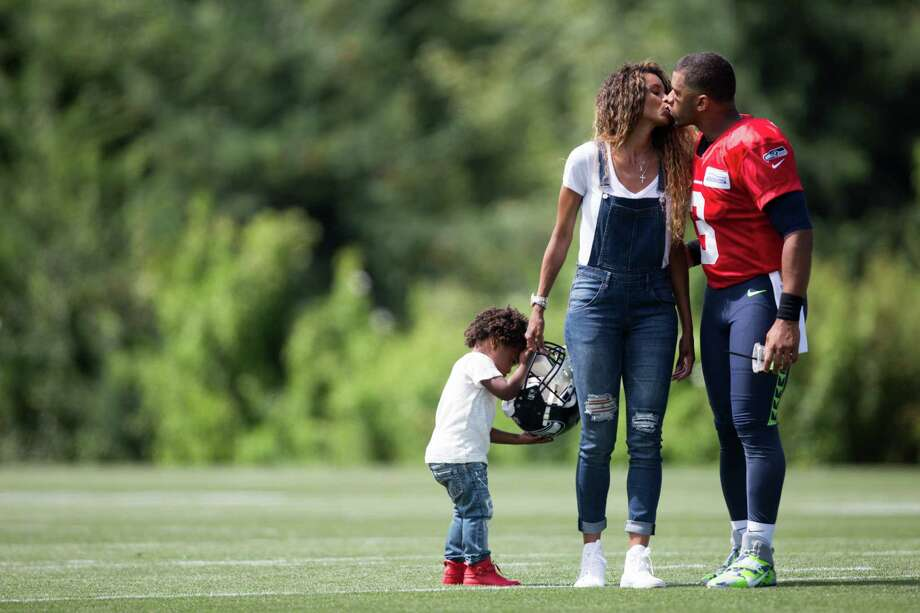 Seahawks quarterback Russell Wilson kisses his wife Ciara and her son Future Zahir Wilburn, following the first day of training camp, at Virginia Mason Athletic Center in Renton on Saturday, July 30, 2016. Photo: GRANT HINDSLEY, SEATTLEPI.COM / SEATTLEPI.COM