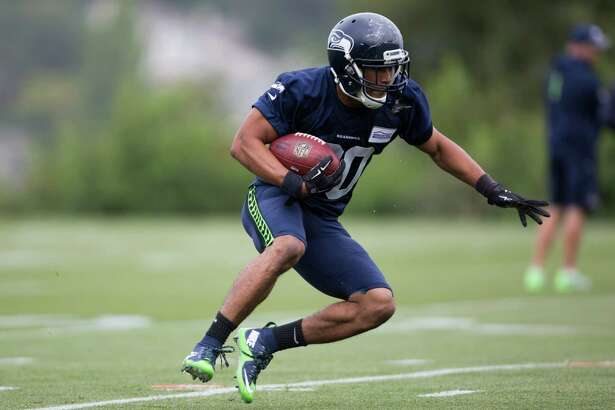 Seahawks rookie running back Zac Brooks completes a drill during the first day of training camp, at Virginia Mason Athletic Center in Renton on Saturday, July 30, 2016.