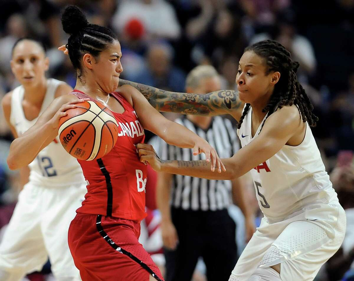 Canada's Kia Nurse, front left, is pressured by the United States' Seimone Augustus during the second half of a women's exhibition basketball game on Friday in Bridgeport.