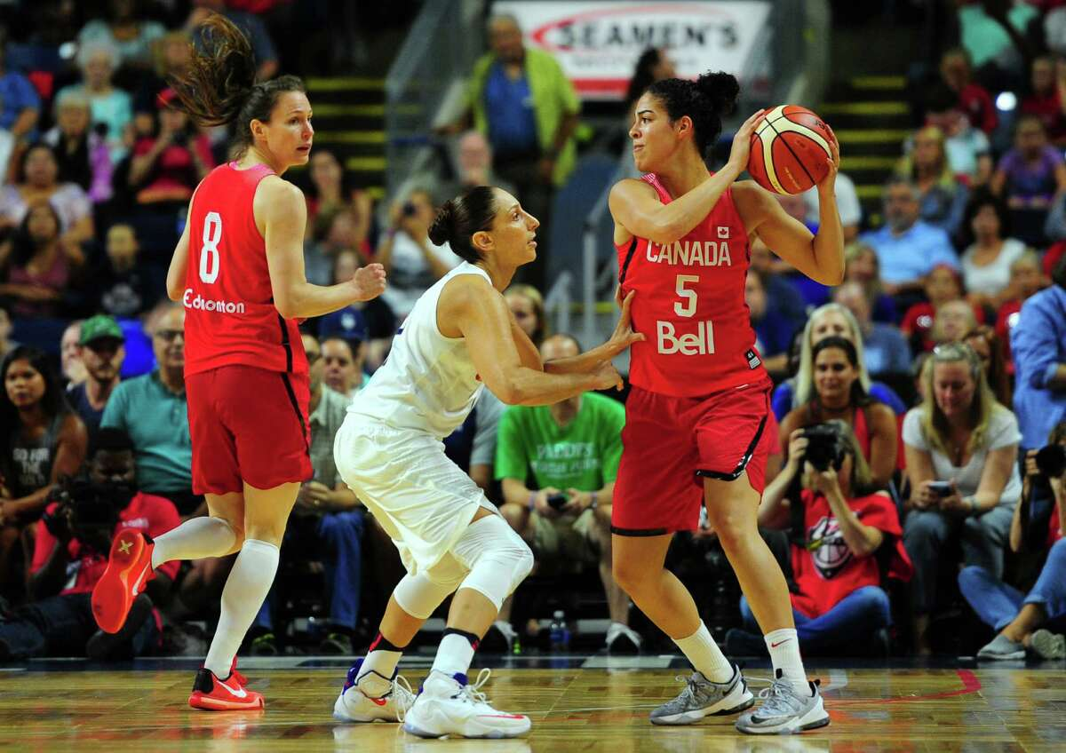 Canada's Kia Nurse, right, looks to pass the ball as USA's Diana Taurasi defends during USA Women's Basketball Showcase action Friday night at the Webster Bank Arena in Bridgeport,