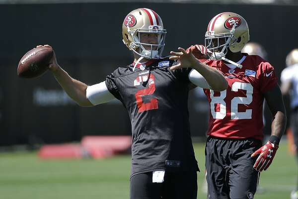 `San Francisco 49ers quarterback Blaine Gabbert (2) throws next to wide receiver Torrey Smith (82) during practice at the team's NFL football facility in Santa Clara, Calif., Tuesday, May 17, 2016. (AP Photo/Jeff Chiu)