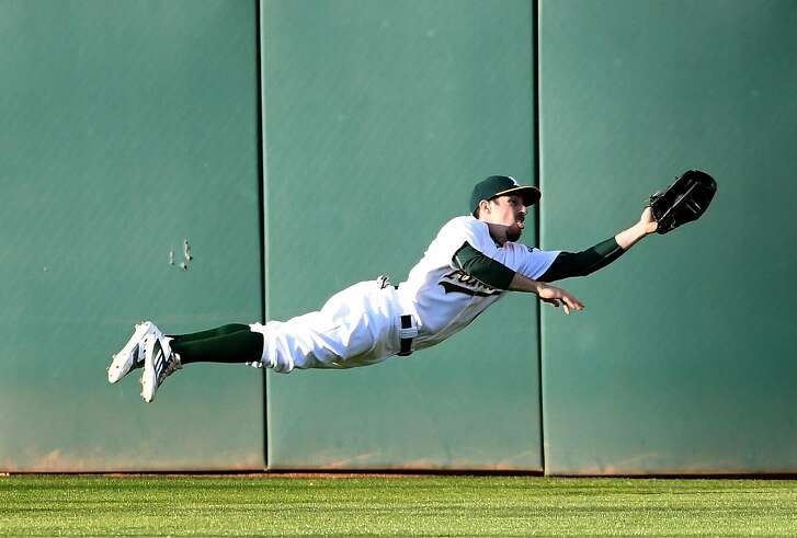 OAKLAND, CA - MAY 27:  Billy Burns #1 of the Oakland Athletics makes a diving catch to rob Ian Kinsler #3 of the Detroit Tigers of a hit in the top of the first inning at O.co Coliseum on May 27, 2016 in Oakland, California.  (Photo by Thearon W. Henderson/Getty Images)