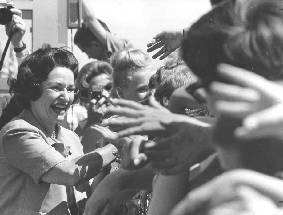 The popular first lady was surrounded by scores of fans and well-wishers here in August 1964. Lady Bird Johnson, an East Texas native, was a political adviser, moral compass and informal therapist for her husband, President Lyndon B. Johnson. Photo: UNKNOWN, STAFF / HOUSTON CHRONICLE