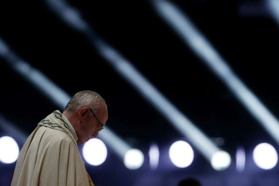 Pope Francis prays during  a prayer vigil on the occasion of the World Youth Days, in Campus Misericordiae in Brzegi, near Krakow, Poland, Saturday, July 30, 2016. The 79-year-old Francis has had an unrelenting schedule since he arrived in Poland on Wednesday for World Youth Days, a global Catholic gathering which culminates Sunday.  (AP Photo/Gregorio Borgia) Photo: Gregorio Borgia, STF / Copyright 2016 The Associated Press. All rights reserved. This material may not be published, broadcast, rewritten or redistribu