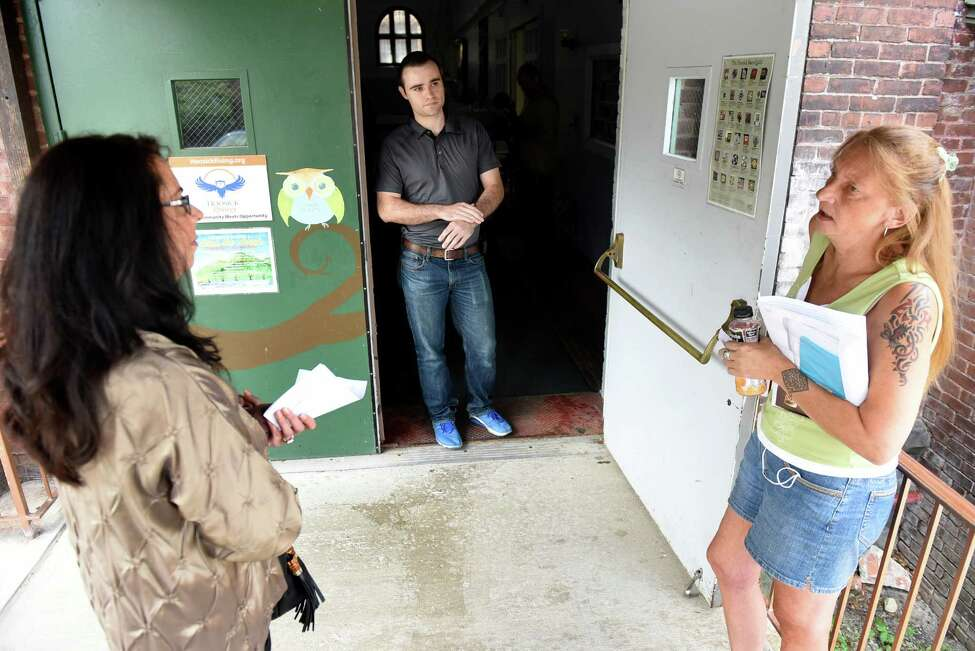 Adam Helman, Department of Public Health emergency representative, center, tries to calm down frustrated residents Michele Baker, left, and Loreen Hackett on Saturday, July 30, 2016, at HAYC3 Armory in Hoosick Falls, N.Y. Only one doctor from Mount Sinai Hospital was present to discuss residents' blood test results, which created a long wait time. (Cindy Schultz / Times Union)