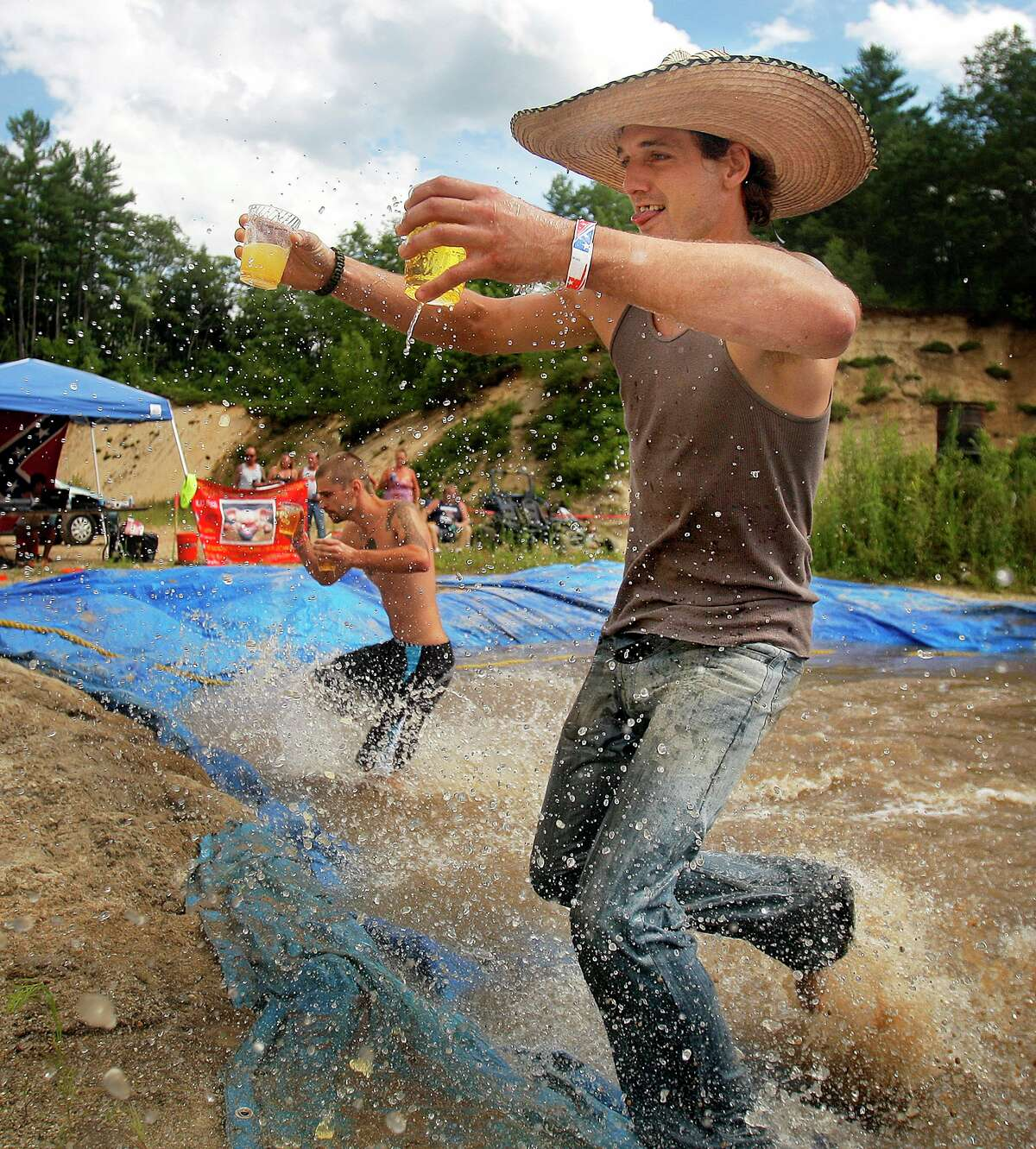 Burt Holmquist of Peru concentrates on keeping his footing while competing in the beer carrying competition at the Redneck Olympics in Hebron, Saturday, August 3, 2013. (Photo by Gabe Souza/Portland Press Herald via Getty Images)
