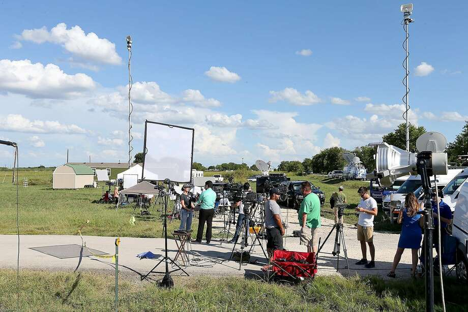 Members of the media gather near the scene of a hot air balloon crash that reports indicate took the lives of 16 people near Maxwell, Texas in Caldwell County on Saturday, July 30, 2016. Photo: Edward A. Ornelas, San Antonio Express-News