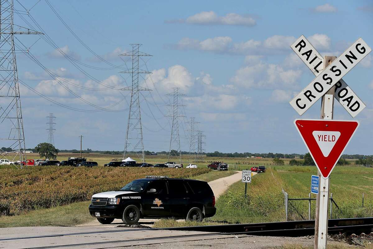 A Texas State Trooper blocks the road near the scene of a hot air balloon crash that reports indicate took the lives of 16 people near Maxwell, Texas in Caldwell County on Saturday, July 30, 2016.