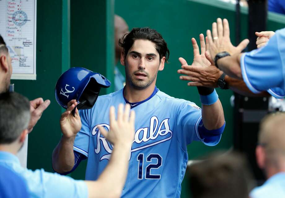 KANSAS CITY, MO - JULY 09:  Brett Eibner #12 of the Kansas City Royals is congratulated by teammates after scoring during the game against the Seattle Mariners at Kauffman Stadium on July 9, 2016 in Kansas City, Missouri.  (Photo by Jamie Squire/Getty Images) Photo: Jamie Squire, Getty Images