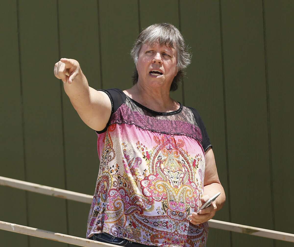 Margaret Wylie, 66, recalls what she saw of the balloon crash as first responders and investigators appear at a scene of the accident that reports indicate took the lives of 16 people near Maxwell, Texas in Caldwell County on Saturday, July 30, 2016. (Kin Man Hui/San Antonio Express-News)
