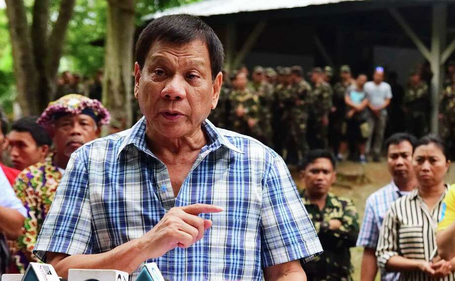 """In this photograph received from the Presidential Photographers' Division on July 30, 2016, Philippine President Rodrigo Duterte speaks to members of the media during a visit to a military camp in Asuncion town, Davao del Norte province.  Philippine president Rodrigo Duterte on July 30 withdrew a unilateral ceasefire with communist rebels after his ultimatum for the group to reciprocate lapsed.    RESTRICTED TO EDITORIAL USE - MANDATORY CREDIT """"AFP PHOTO / RENE LUMAWAG / PRESIDENTIAL PHOTOGRAPHERS DIVISION"""" - NO MARKETING NO ADVERTISING CAMPAIGNS - DISTRIBUTED AS A SERVICE TO CLIENTS  / AFP PHOTO / PRESIDENTIAL PHOTOGRAPHERS' DIVISION / RENE LUMAWAG / RESTRICTED TO EDITORIAL USE - NO ARCHIVESRENE LUMAWAG/AFP/Getty Images Photo: RENE LUMAWAG, Stringer / AFP or licensors"""