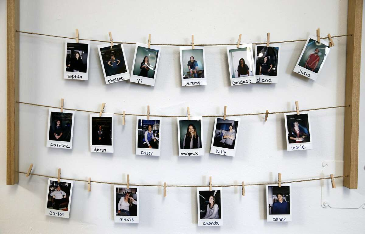 Photos of employees are clipped to a wall at Gusto in San Francisco, Calif. on Thursday, July 28, 2016. The online payroll and benefits company for small businesses is improving the benefits for its own workforce by adding unrestricted fertility coverage in the healthcare package.