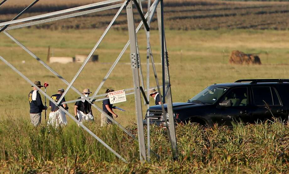 First responders and investigators appear at a scene of a hot air balloon crash that reports indicate took the lives of 16 people near Maxwell, Texas in Caldwell County on Saturday, July 30, 2016. Photo: Edward A. Ornelas, San Antonio Express-News