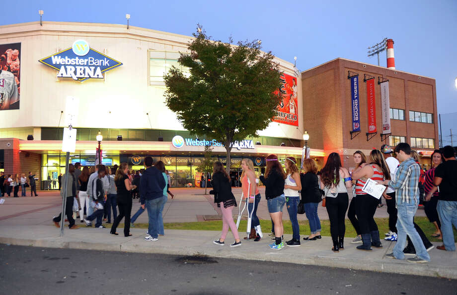 Fans outside waiting to see Tegan and Sara, and Fun perform at the Webster Bank Arena in Bridgeport, Conn.in 2013. Photo: Christian Abraham / File Photo / Connecticut Post