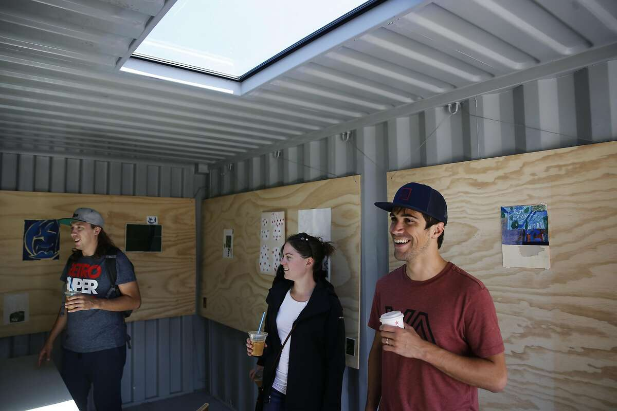 Nearby residents (l to r) Kory Mathewson, Lana Cuthbertson and David Belo check out a shipping container that has bee transformed into an art gallery at the Hayes Valley Artworks, an art activation site where the Fell St. offramp used to be near Octavia, in San Francisco, California, as seen on Sat. July 30, 2016.