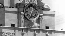 Smoke rises from sniper Charles Whitman's gun on Aug. 1, 1966, as he fires from the tower of the University of Texas administration building, killing 16 people and wounding 31 in his 96-minute massacre.