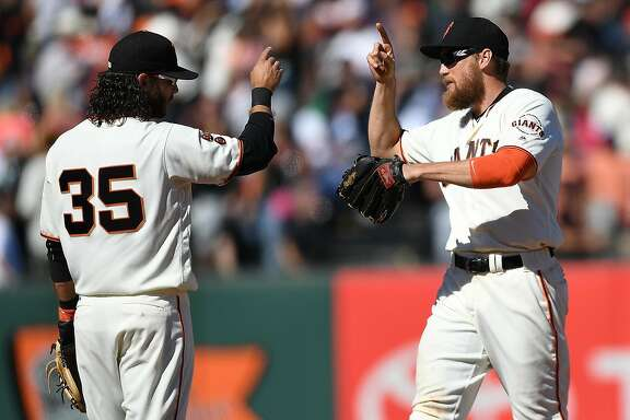 SAN FRANCISCO, CA - JULY 30:  Hunter Pence #8 and Brandon Crawford #35 of the San Francisco Giants celebrates defeating the Washington Nationals 5-3 at AT&T Park on July 30, 2016 in San Francisco, California.  (Photo by Thearon W. Henderson/Getty Images)