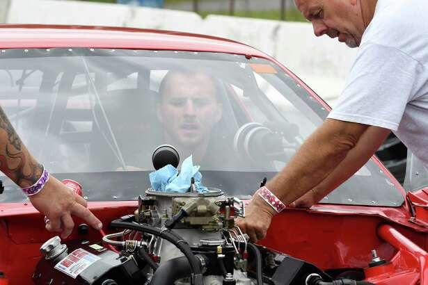 Bobby Smith, right, of Hopewell Juction does work on his son Robbie Smith IROCZ during Drag racing at Lebanon Valley Dragway on Saturday July 30, 2016 in West Lebanon, N.Y. (Michael P. Farrell/Times Union)