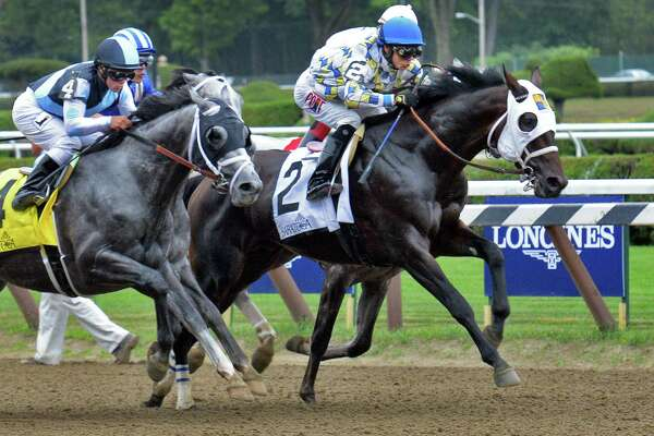 Laoban, #2, with Jose Ortiz up takes an early lead at the start of the Jim Dandy at Saratoga Race Course Saturday July 30, 2016 in Saratoga Springs, NY.  (John Carl D'Annibale / Times Union)