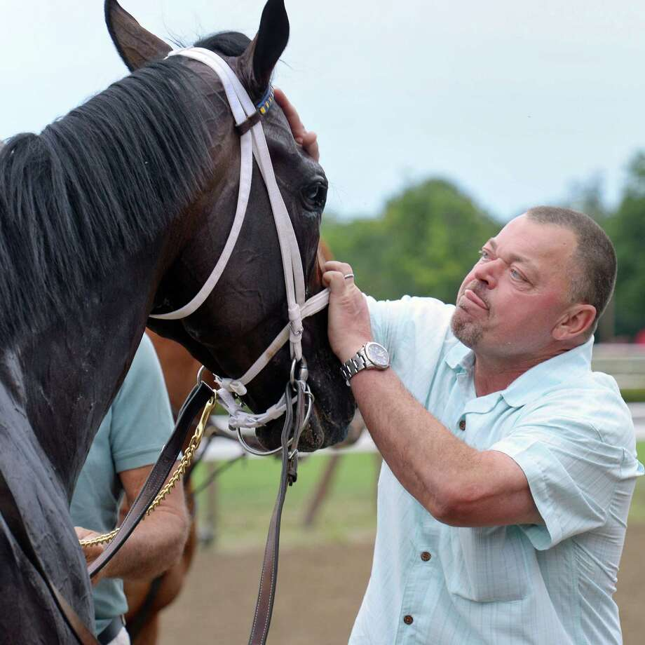 Trainer Eric Guillot greets Laoban at the winners circle after victory in the Jim Dandy at Saratoga Race Course Saturday July 30, 2016 in Saratoga Springs, NY.  (John Carl D'Annibale / Times Union) Photo: John Carl D'Annibale / 20037488A