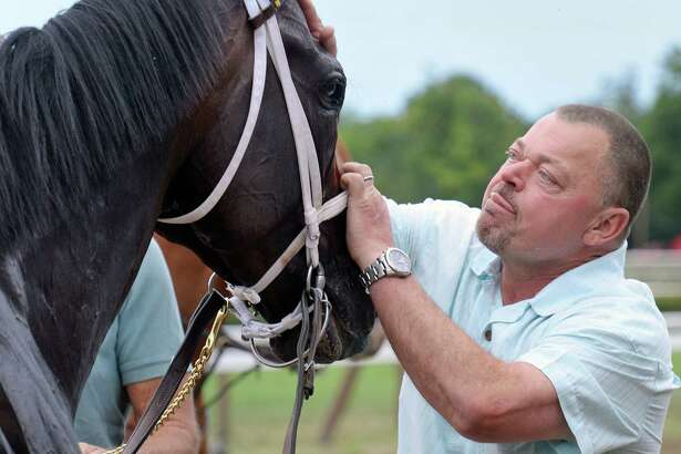 Trainer Eric Guillot greets Laoban at the winners circle after victory in the Jim Dandy at Saratoga Race Course Saturday July 30, 2016 in Saratoga Springs, NY.  (John Carl D'Annibale / Times Union)