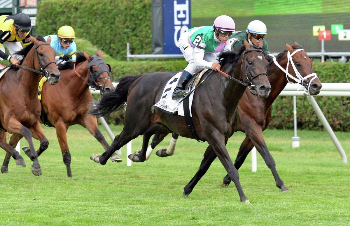 Jockey Javier Castellano aboard Flintshire edges out Jose Ortiz on Grand Tito to win the Bowling Green Handicap at Saratoga Race Course Saturday July 30, 2016 in Saratoga Springs, NY. (John Carl D'Annibale / Times Union)