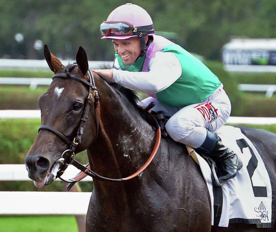 Jockey Javier Castellano gives Flintshire at pat on the head after winning the Bowling Green Handicap at Saratoga Race Course Saturday July 30, 2016 in Saratoga Springs, NY.  (John Carl D'Annibale / Times Union) Photo: John Carl D'Annibale / 20037488A