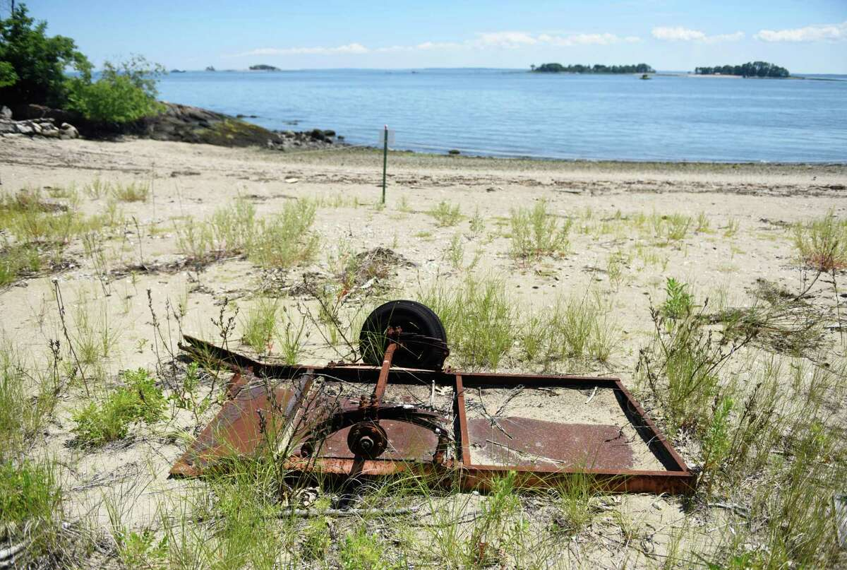 Farm equipment dating back to when Calf Island was used as breeding ground for cows sits on the beach of the island in the waters of the Long Island Sound off the coast of Greenwich, Conn. Wednesday, July 27, 2016. Calf Island is Greenwich's largest offshore island, 31.5 acres, and is located about 3,000 feet south of Byram Harbor. Calf Island is one of the islands owned by the Stewart B. McKinney National Wildlife Refuge and boasts a diverse ecosystem including tidal wetlands, flats, rocky shore, sandy beach and mixed forest that provides an excellent bird habitat.