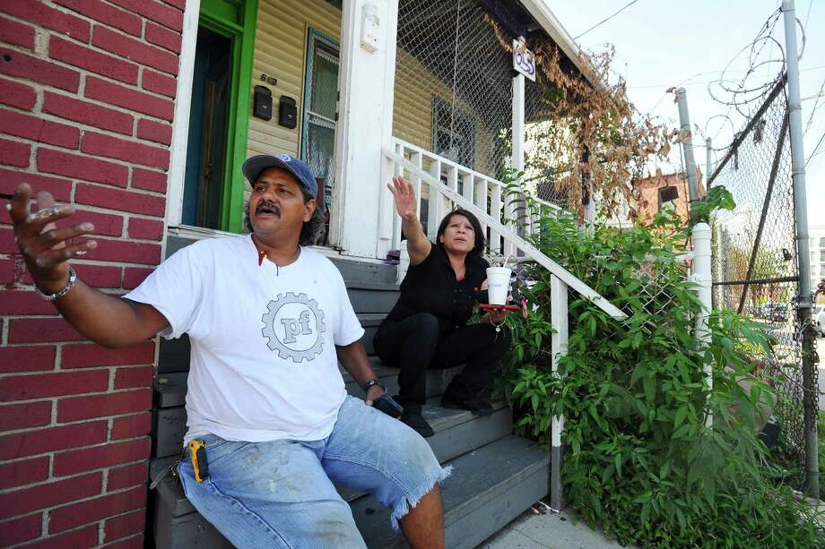Maryana Gutierrez, right, and Jose Garcia discuss what its like to live and work in the South End after the recent violence. Photo: Michael Cummo / Hearst Connecticut Media / Stamford Advocate