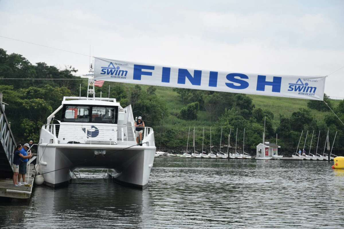 The Spirit of the Sound powerboat was donated by Norwalk Maritime Aqaurium to take cancer survivors out to support friends and family members who are swimming for them. This is the 29th annual Swim Across the Sound fundraiser and it's organized by the St, Vincent's Medical Center Foundation. Swimmers make the journey from Port Jefferson, New York to Captain's Cove Marina in Bridgeport, 15.5 miles in all.