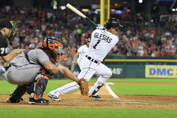 Detroit Tigers' Jose Iglesias hits a walkoff RBI-single in the ninth inning of a baseball game against the Houston Astros, Saturday, July 30, 2016, at Comerica Park in Detroit. (AP Photo/Lon Horwedel)